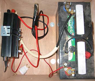 Deep cycle battery with inverter connected to dual charging system